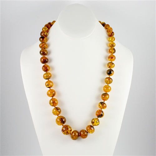amber necklace the beads on this beautiful necklace are circular shaped and are graduated  in size HVURCIS