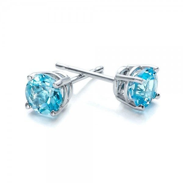 blue topaz earrings ... blue topaz stud earrings - laying view ... AQMBYNC