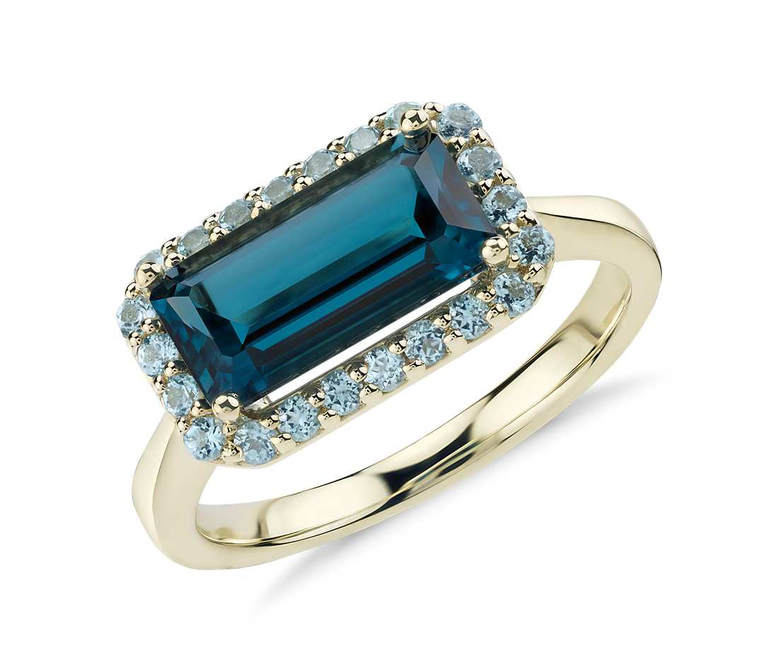 topaz ring robert leser east-west london blue topaz halo ring in 14k yellow gold (11x5 excmpfz