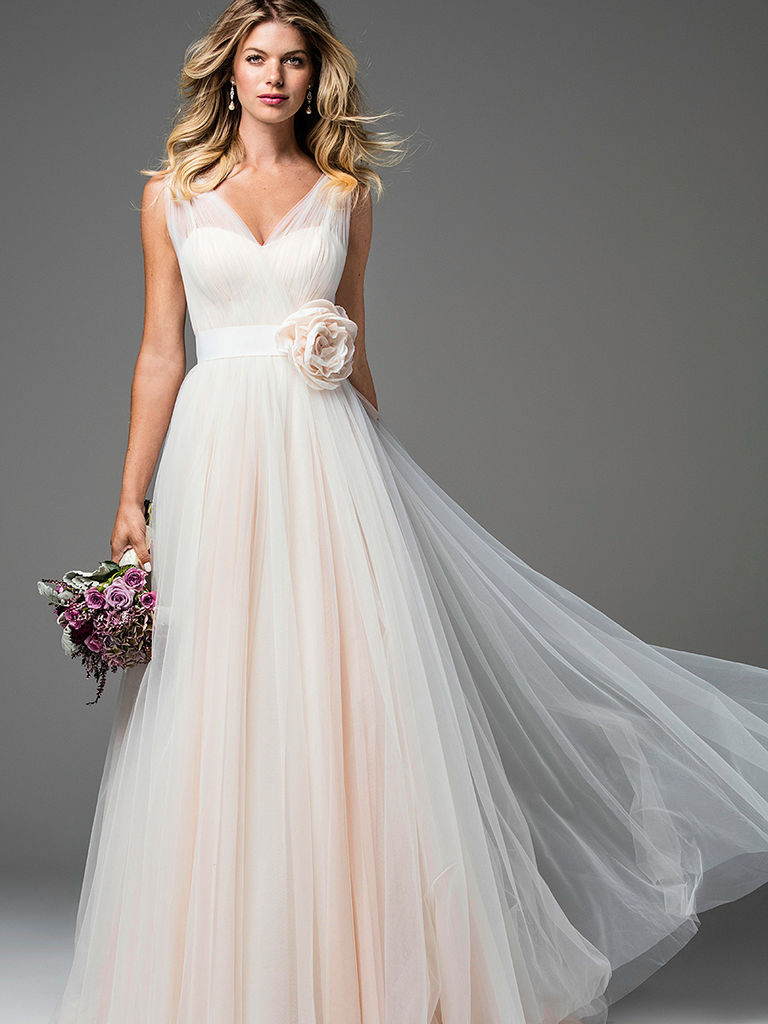 Wearing a blush wedding dress on your great day