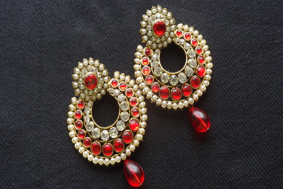 designer earrings with red and white stones and red tear droplets. zacymqj