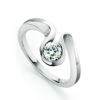 unusual engagement rings a voluptuous curve of 18ct white gold encases a single sparkling diamond.  the wave eewlfrc