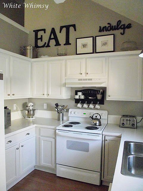 black accents, white cabinets | Kitchen cabinets decor, Decorating .
